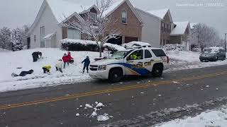 Kids take on police officers in friendly surprise snowball fight