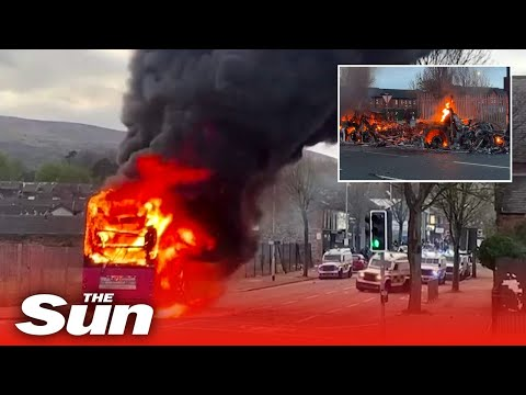 Bus firebombed and police attacked during night of violence