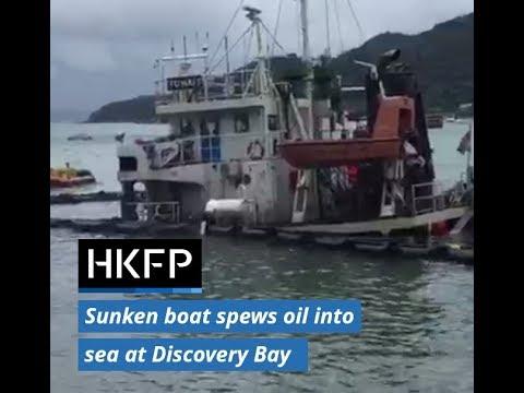 Sunken boat spews oil into sea following Typhoon Hato in Hong Kong