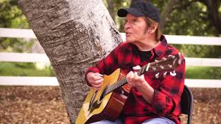 John Fogerty sings Lookin' Out my Back Door from his home.