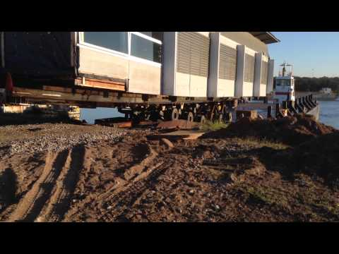 House moving, Part 3 of building going to Manly Yacht Squadron by barge
