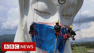 Giant Buddhist statue gets Covid face mask in Japan - BBC News