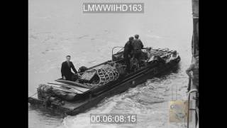 INVASION, FRANCE - GERMAN OBSTACLES ON BEACH; BRITISH SOLDIERS; FRENCH CIVILIANS SHOVE - LMWWIIHD163