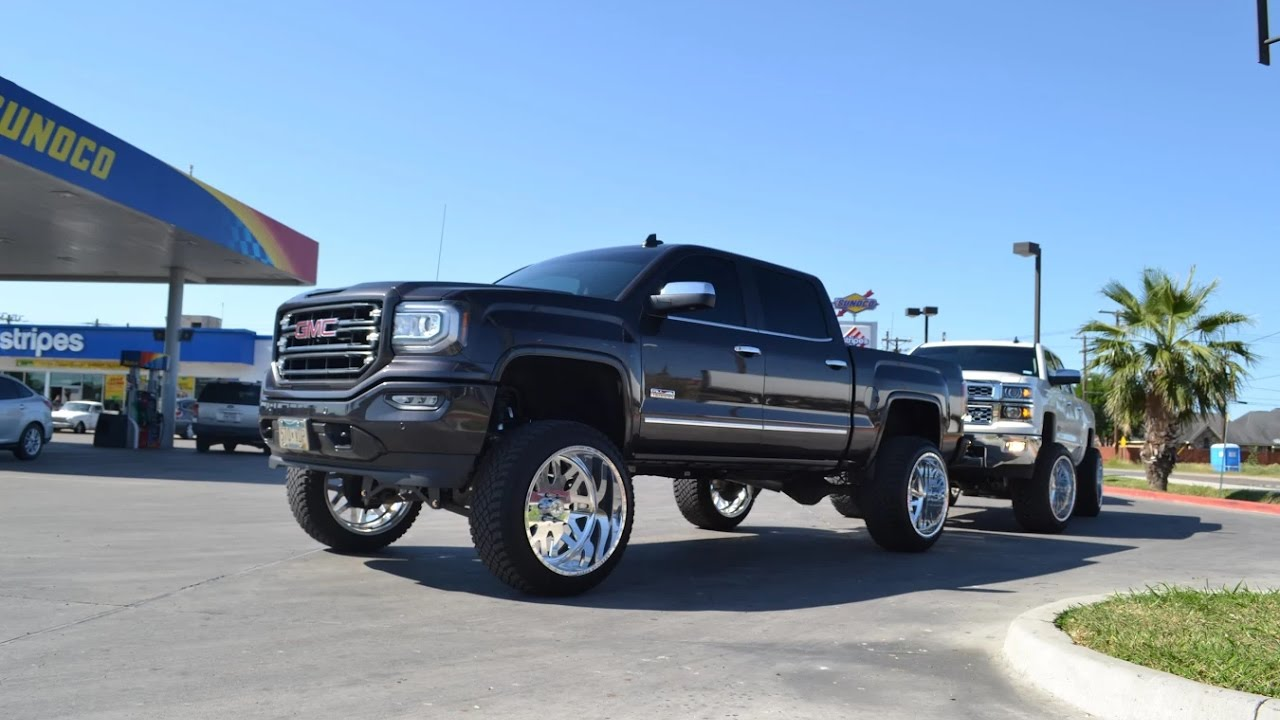 "TWO SIK LIFTED TRUCKS on 9"" lifts running 24X14 American ..."