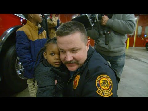 Firefighter reunites with child he helped save from burning building