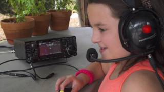 9 year old grace km4txt working va4eee kc1cwf and ac9ed on 20 meters with an icom ic 7300