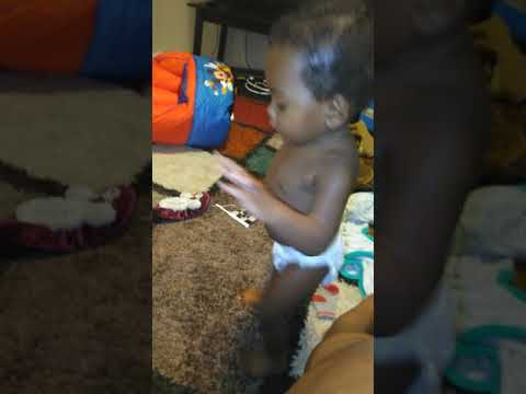 Toddler dances African style