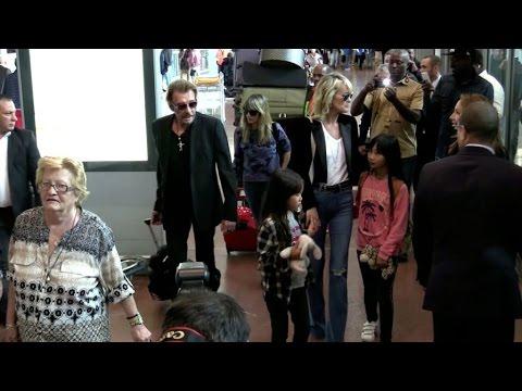 EXCLUSIVE: Johnny Hallyday, Laetitia, Jade and Joy arriving at Paris airport