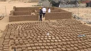 Gazans rebuild homes with mud thumbnail