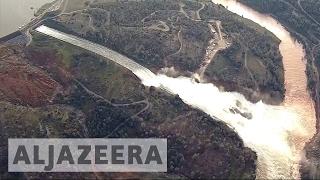 Evacuations ongoing as California dam danger lessens