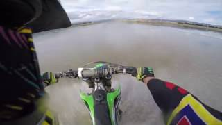 Dirtbike hydroplaning across Lake Omeo