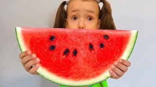 UT kids Play with Colorful Watermelon