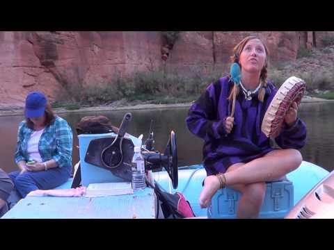 A trip down Colorado river. with the guide singing a song.