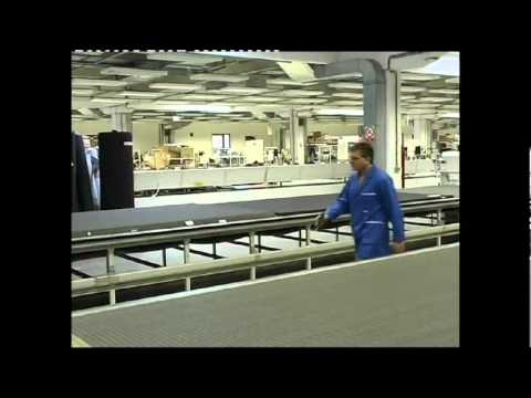 Seating Manufacture, fabric spreading, multi ply cutting machine and fabric handling.avi