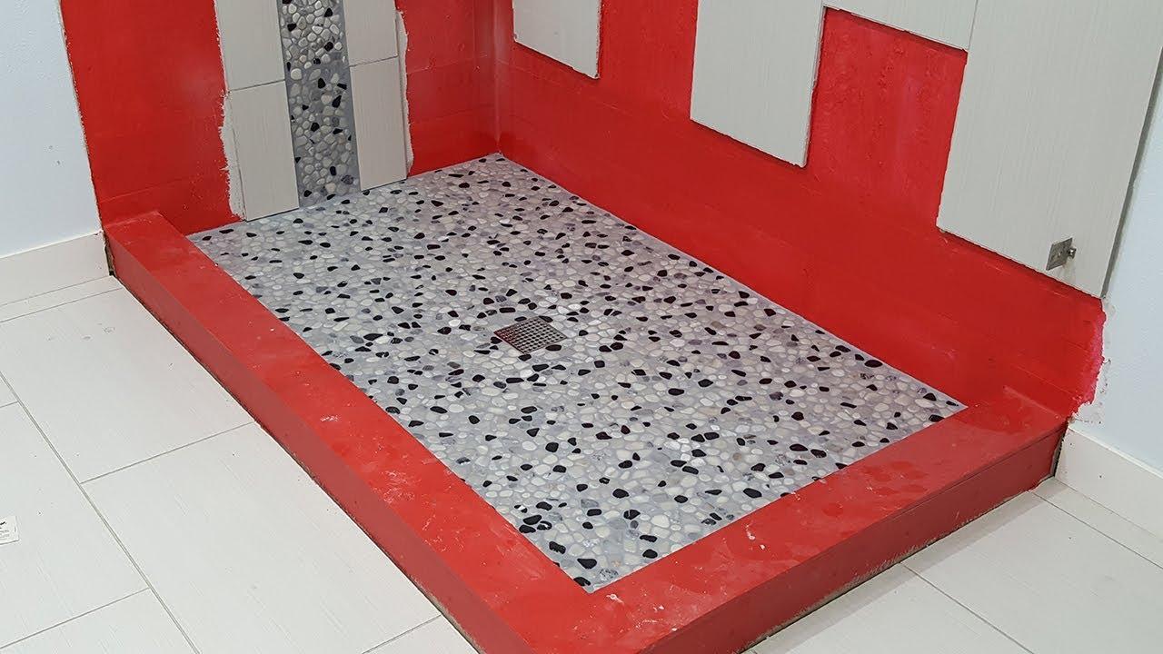 install a pebble tile river rock shower floor grout perestrojka pola v dushevoj zatirka