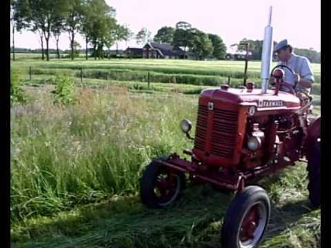 Farmall Super A Mowing Grass