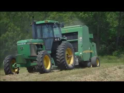 Baling Hay 2015 with a JD 4450 and a JD 567 Round Baler