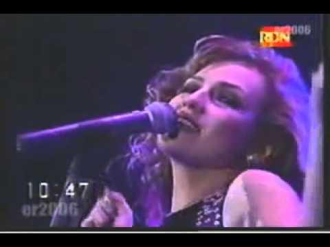 Thalia singing a Filipino song-