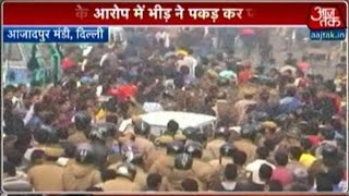 delhi tension in azadpur after mob beats man to death