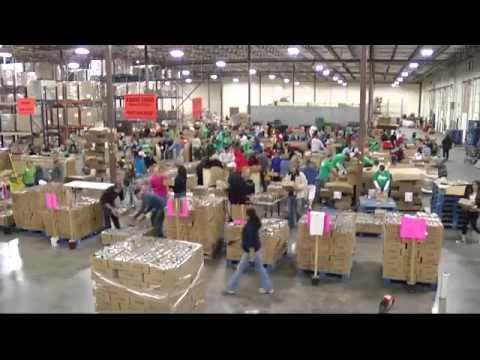 Volunteers help sort food at Roadrunner Food Bank
