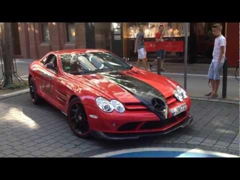 again red/black Mercedes SLR McLaren in Frankfurt - parking, open door, interior