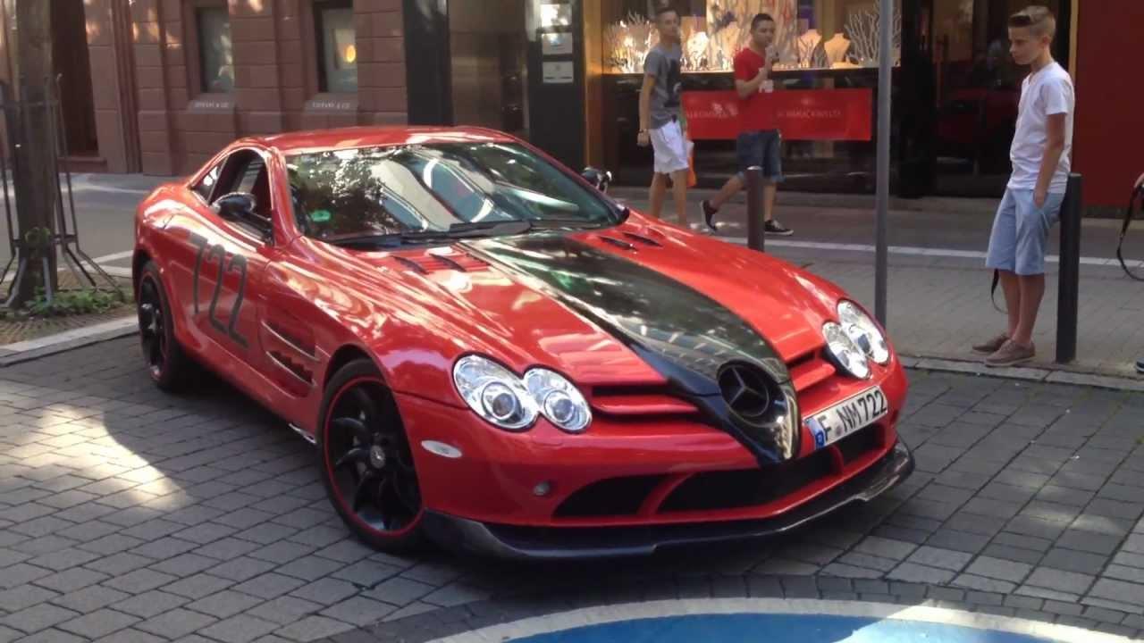 again red/black mercedes slr mclaren in frankfurt - parking, open
