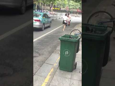 Chinese LAK amputee one leg girl stepping in street on double crutches