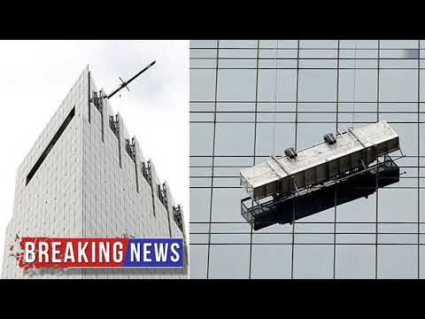 HOT NEWS Window washers left dangling after collapse in Manhattan | Daily Mail Online