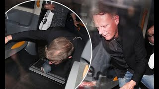 Antony Cotton tumbles into a taxi after Kylie Minogue's star-studded 50th birthday bash