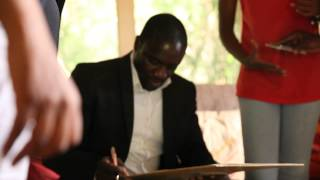 Ruby gets an autograph signed by Akon