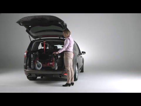 Lift a power wheelchair into a car