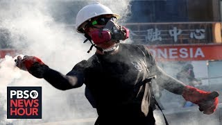News Wrap: Police and protesters clash again in Hong Kong