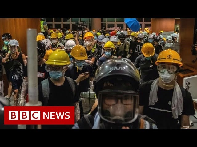 Protesters removed from HK parliament building - BBC News