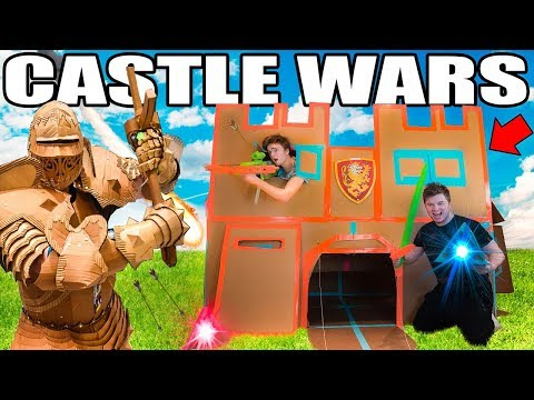 TWO STORY BOX FORT CASTLE WARS!!   Sword Fighting, Archery & More!!!