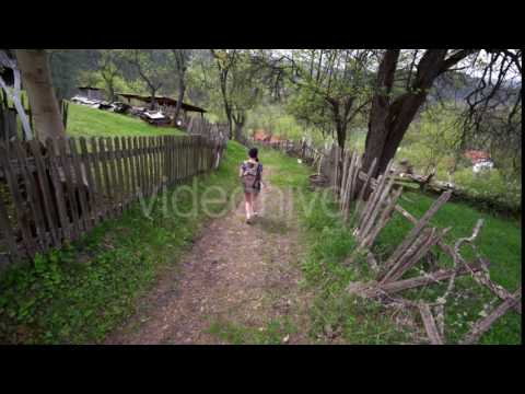 Asian Girl Walking On a Hill Across a Village - Stock Footage | VideoHive 16604694