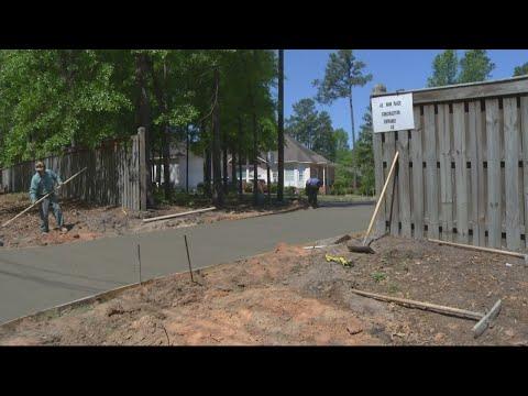 Tax commissioner's driveway raises questions