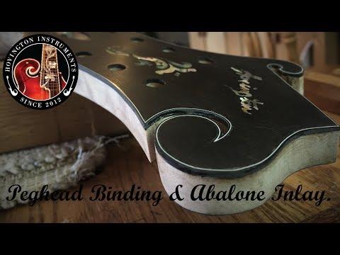 F-Style Peghead Binding & Abalone Inlay.