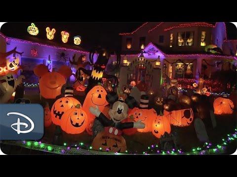 couple celebrates a disney halloween in their yard disney parks - Disney Halloween Decorations