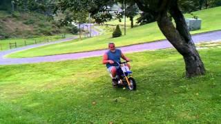 Pop rides the Mini Bike.