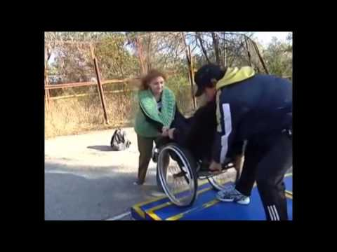 how to get a wheelchair down stairs