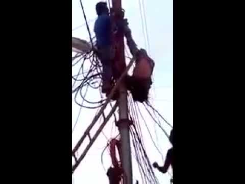 MAN DIES ON ELECTRICITY POLE