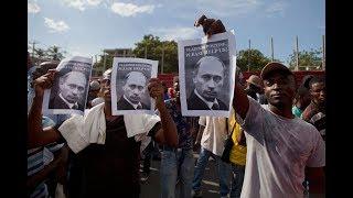 Протестующие на Гаити сожгли флаг США и попросили Путина о помощи
