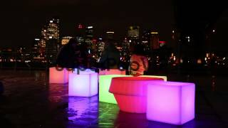 Long Shot, People Sit On Illuminated Stools With Sydney C...
