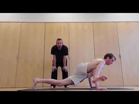 Yoga transition from eight angle pose to flying splits. Ashtavakrasana to eka pada koundinyasana
