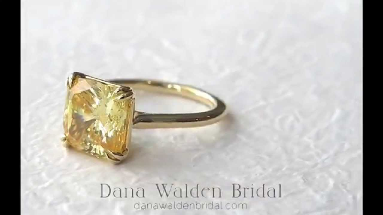 600 carat yellow sapphire double claw prong yellow gold