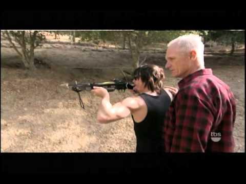 Matt Riedy teaches Norman Reedus the crossbow