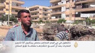 تطوير آلة لتدوير النفايات بحي الوعر بحمص