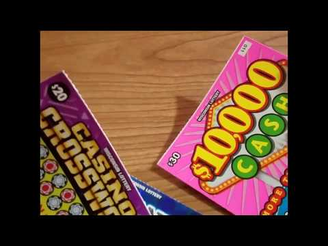 $80 in scratch off lottery tickets $10,000 cash and instant million payout and a crossword
