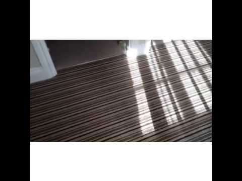 Cheltenham Wool Loop Pile Striped Carpet Fitted To A Landing And