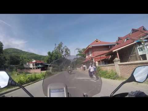 Entering Mongla township on a Myanmar motorcycle tour